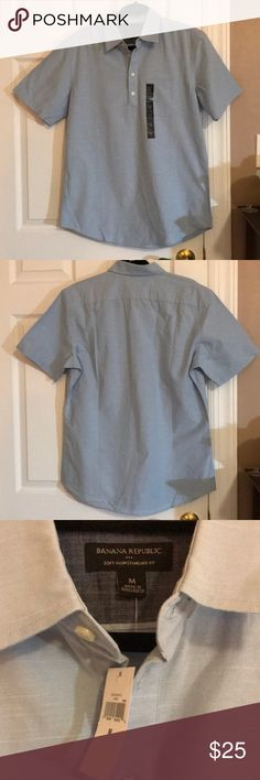 "Banana Republic Short Sleeve Standard Fit Shirt Light blue short sleeved shirt. Collared and four buttons . One breast pocket. 100% cotton. 28"" shoulder to bottom. 21.5"" armpit to armpit. NWT. Banana Republic Shirts Casual Button Down Shirts"