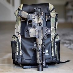 Camo backpack and matching gun
