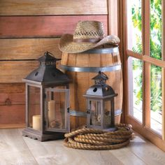 The stately design of these wooden candle lanterns will dress up your home, indoors or out. The clear glass panels and the antiqued frame are the perfect accent to beautiful candlelight, and the lantern can rest on its base or be hung from the top loop. Each sold separately.