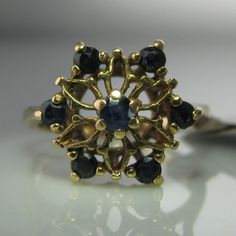 A beautiful yellow gold ring with seven sapphires set in a lovely high setting with beautiful gold workmanship. Ring size: K (This ring can be resized if required). Vintage Diamond, Vintage Rings, Unique Vintage, Vintage Jewelry, Diamond Rings, Diamond Engagement Rings, Gemstone Rings, Engagement Jewelry, Galway Ireland