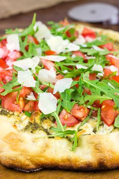 Brushed with pesto and then topped with fresh tomatoes and arugula, this Bruschetta Pizza is a delicious summer meal! Serve up a slice tonight! Bruschetta Pizza, Pesto Pizza, Pizza Pizza, Pizza Maker, Veggie Pizza, Pizza Party, Pizza Dough, Pizza Recipes, Vegetarian Recipes