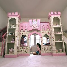Very cool idea for a little girl...bed hidden behind castle...go up steps n come down slide