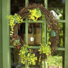 Add spring cheer to your front door with our DIY seasonal containers and wreaths.