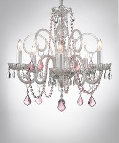 Give the room an injection of glitz and glamor with this crystal encrusted chandelier. Decadently designed with a classic silhouette and romantic blush-colored jewels, it beautifully brightens the room. 24'' W x 25'' HWrought iron / crystalShades: fabricRequires five 40 W candelabra bu...