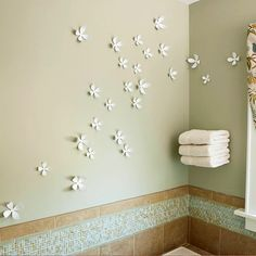 love the idea of artful walls like this... and floating shelving for towel storage!