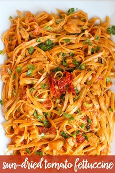 A DELICIOUS copycat recipe of Cheesecake Factory's Sun-Dried Tomato Fettuccine. It is AMAZING!! Recipe on { lilluna.com } Lots of yummy ingredients combined with fettuccine noodles and sun-dried tomatoes.