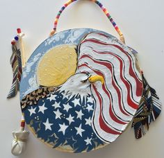 """""""BRAVE NATION"""" ~ $ 164  ~  10inch primitive drum & beater ~ designed & hand-painted by artist:  Sharon Gilbertson  (contact artist on website)  For clothing collection - follow link on website to Sharon's VIDA VOICES shop.  Thank you."""