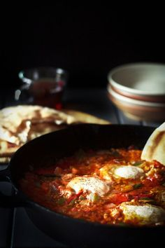 Shakshuka #recipe! Poached eggs over a bead of perfectly spiced fried tomatoes, onions and green peppers. Out-of-this world!