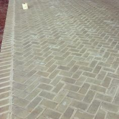 Herringbone patio at one of my current jobs. Love the gray brick