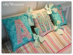 Looking for your next project? You're going to love Spell a name Tied Cushions by designer Lillyblossom.