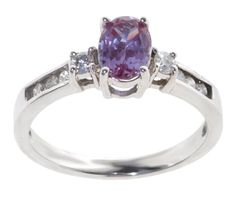 Purple Alexandrite with diamonds on the sides.  I want this to be my engagement ring so bad! It's so unique and so me.  It's also my birthstone, so it makes it even that much better. <3 <3 <3