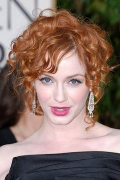 Christina Hendricks really stands out with this classy hair style. Her curled hair is up in the back and the curls are left loose on the sides.  in the front. carpet. Her hair is cut medium length.