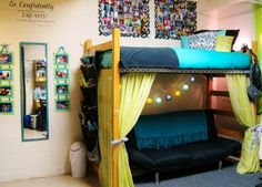 21 Ideas for Smart and Even Hilarious Dorm Room Decor - We've always wondered why more students don't hang curtains under their lofted bed. Futon underneath, string of paper lanterns, and you've suddenly got a private escape from the roommate and the world around you. Relax, study, be at peace. Great color selection and a simple berber dorm rug.