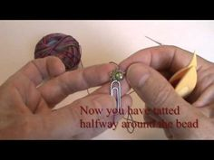 Adding a bead to center of tatted mock ring - YouTube
