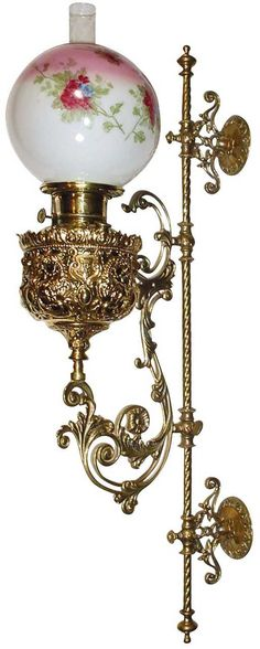 Lot: 1251: Lighting, wall lamp, adjustable brass kerosene la, Lot Number: 1251, Starting Bid: $1, Auctioneer: Rich Penn Auctions, Auction: The Mark & Connie Stellinga Collection, Date: April 30th, 2006 EDT