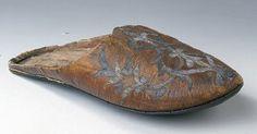 "Leather clog owned by the Swedish king Gustav II Adolf in the 1600´s. Made of linen saffian with wire embroidery. Made in oriental style or made in the M.E.  Looks and is described very much like the Ottoman Turkish overshoes of the same time.  It is described as having the narrow strip ""heel"" underneath as well (the ""horseshoe"" shaped piece)"