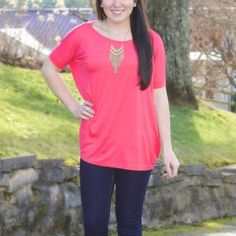 Coral Piko Short Sleeve Top Brand new with tags attached! Fabric is super soft and stretchy (95% bamboo, 5% spandex); This top looks cute with just about everything! Piko Tops