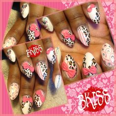 Short oval nails with cheetah print and 3D acrylic bows featuring pink. Something flashy yet classy. Conversation starter if I do say so myself. Too cute!!