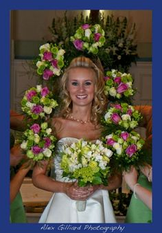 Green, white, and pink bouquets surround Bride for a great picture!