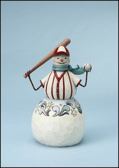 """Jim Shore Christmas  Baseball Snowman  Three Balls, No Strikes    This sporty snowman is ready to play baseball! his arms are made of twisted wire.    Specifications:  Size: 6""""H  Materials: Stone Resin  Note: Unique variations should be expected; hand painted    Your Price: $25.00"""