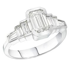 18KW Step Ring Engagement Ring with an Emerald cut center diamond.