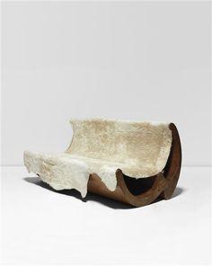 José Zanine Caldas; Wood and Hide 'Zanine' Sofa,c, 1970.