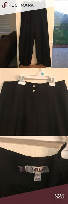 """Jennifer Lopez high waist flowy dress pants NWOT. Took tags off before trying them on, never worn other than trying them on. Way to long for me- I'm 5'2"""". The ends dragged on the floor even wearing 3"""" heels. Would work well with a nice top. Jennifer Lopez Pants Trousers"""