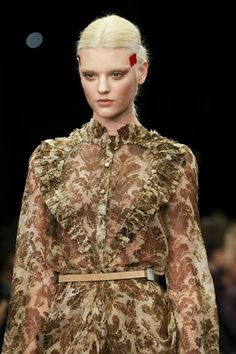 Givenchy - Abstract animal skins and surfaces - snake and butterfly, conversational, and abstract micro wing details.