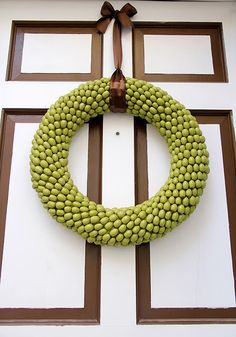 acorn wreath: wreath form, LOTS of hot glue, and spray paint