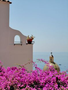 A Spanish view of the Med thru the bouganvilla....................