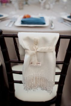 pashmina favor, pretty, practical and acts as a chair cover. Would be a favor I would LOVE as a guest