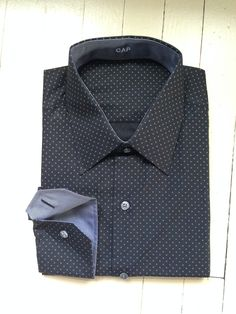 J. Hilburn fall fabric.  Black with small white circles.  Grey contrast fabric inside cuff and collar.