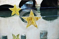 Sparkling star decorations and bridge on Sile river during winter holidays in Treviso city, in Veneto, Italy. Holiday City, Sparkling Stars, Star Decorations, Christmas Star, Winter Holidays, Bridge, Italy, River, Stock Photos