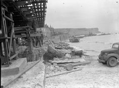 Mulberry Harbour, Arromanches: Wreckage after the great storm in the channel that badly damaged the Mulberry Harbours, strewn on the beach at Arromanches.