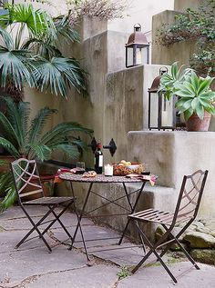 In one of the gardens, a bistro set stands ready for an idyllic rendezvous on Kendall Conrad's romantic Spanish patio.