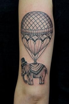 Balloon tattoo. With an elephant. God, that's precious!