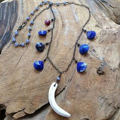 """Big Blue Sea"" tusk necklace with Lapis Lazuli, Chalcedony, Ruby, Black Spinel, oxidized Sterling Silver, and Bone. By My Peace And Love"