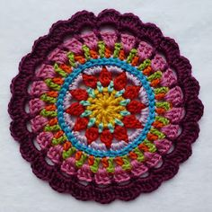beautiful Mandela... link to free pattern- This could easily be turned into a crochet rug pattern