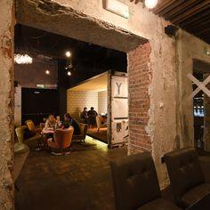 The post-industrial character of Bytom as a whole is very much in evidence at Fantom – brickwork breaks through chipped plaster, and a steel container has been shipped in to act as a snug that doubles as a stage area for live music...