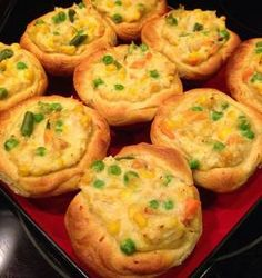 Mini Pot Pie Muffins 2 cans flaky layers biscuits  2 cans cream of chicken soup  2 cups of Cooked Chicken Chopped Veggies (your choice) Cheese  Read more at http://myfridgefood.com/recipes/entree-chicken/mini-pot-pie-muffins#yMEbiUVIJWxXWUXe.99