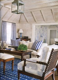 Blue & white palette, spool chair.  Navy fabrics are so sophisticated. Love the whimsy of a spool chair.