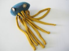 This weeks Etsy discovery…Debivanzyl, owned by designer Debi van Zyl. Her New Recycles are made from once-lived materials and lost buttons. Meet Aiko: beast no. 159, a one-of-a kind toy. I think she is a squid or a jellyfish, either way she is awesome. Aikos parents were an aqua blue pull-over and yellow cardigan. Her eyes were handed-down to her from an antique shop. Visit Debis blog and see what she is up to; meet her dog Arrow too!