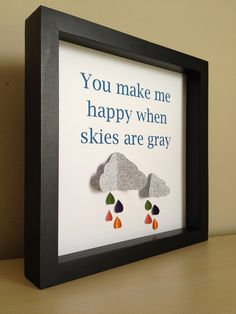 You make me happy, 3D paper art, with gray clouds and raindrops.