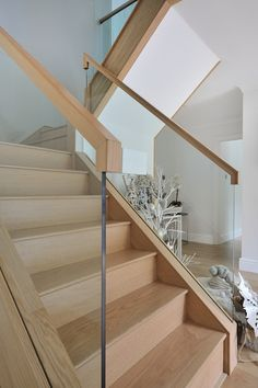 A contemporary, oak and glass staircase with a galleried landing that was in keeping with the newly renovated home.