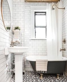 This beautiful bathroom from completely stopped me in my tracks. It incorporates everything I love. Patterned tile ✓️wood tones ✓ gold accents ... & Vintage style bathroom with black \u0026 white tile claw foot tub ...