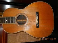 1927 MARTIN O-42  ACOUSTIC GUITAR  ONLY 52 MADE FROM 1898 THRU 1927. O size body, Brazilian rosewood sides and back,  Ebony fingerboard,  With spruce top.
