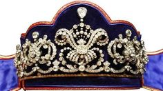 1915 The Hohenburg Tiara, Kochert, featuring two scroll and foliate motifs, w diamonds clusters, each side of a respendant central bow, at the centre of which is a large cushion-cut diamond, and topped w a larger pear-shaped diamond, still used by the Hohenberg family
