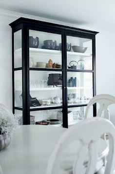 Love the cabinet; light and airy but the dark frame really grounds it and adds contrast against the shelves