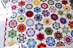 by Frederick of the DC Modern Quilt Guild. Totally mind-bogglingly amazing! EPP'd throughout.
