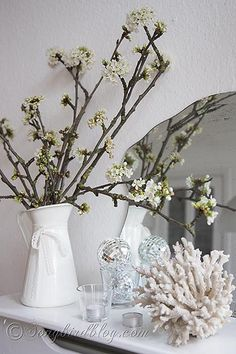 Spring mantel decoration with apple blossoms, coral and disco balls.
